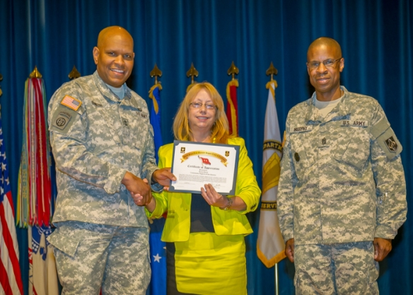 United States Army Maneuver Support Center of Excellence Commanding General Leslie C. Smith,  and Command Sergeant Major Terrence Murphy present Karen Hood, Pulaski County Tourism Bureau with Certificate of Appreciation for Community Supporter of the Quarter. Photo by M. Curtis.